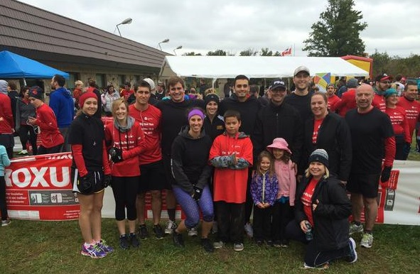 Crozier & Associates' team arrive with family members for the United Way Milton's Big Red Run.