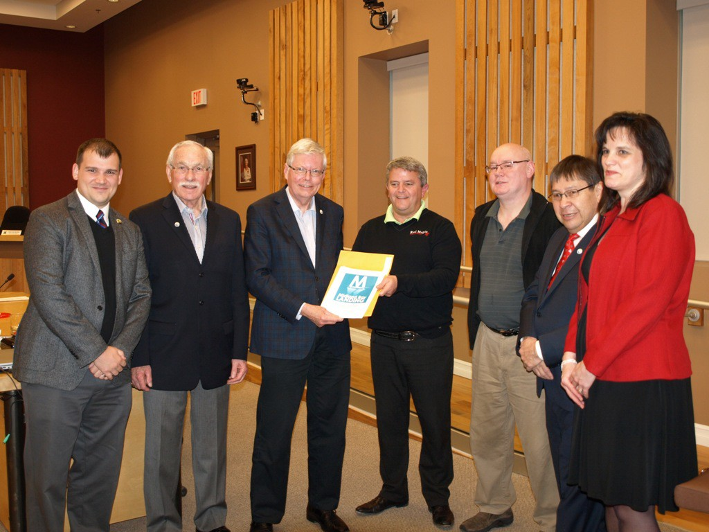 From left: Councillors Jonathan Main and George MacDonald;  Town of Midland Mayor Gordon McKay;  Ken Michaud, Mountain Ridge Development;  Councillors Glen Canning and Jack Contin;  Town of Midland CAO Carolyn Tripp.